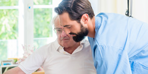 Carer providing homecare support to elderly person