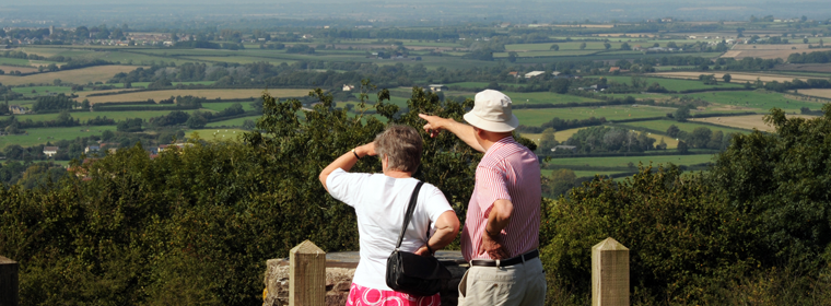 Two people looking at the fields and view of the bridge in South Gloucestershire
