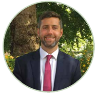 Leader of South Gloucestershire Council stood in front of a green space
